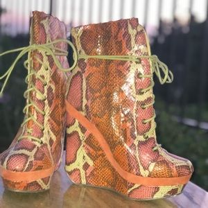Snake print wedge boots